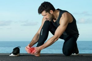 Athlete-treating-a-sports-injury